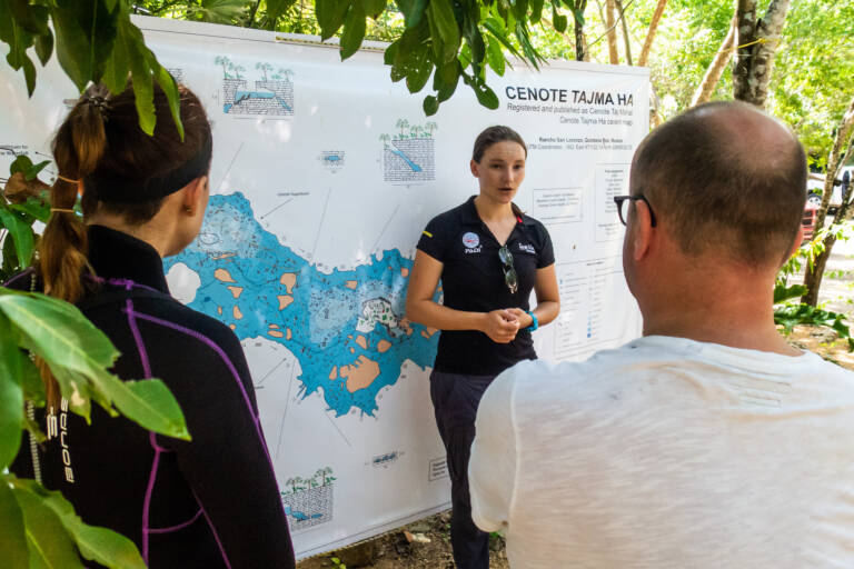 An instructor gives a briefing at a cenote